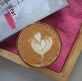 Foto piccolo latte di Logika Coffee
