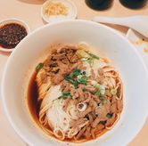Foto Shredded Beef Noodle With Spicy Szechuan Sauce di Din Tai Fung Noodle Bar