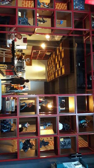 Foto 4 - Interior di Addictz Cafe & Toys oleh dimasdjoko