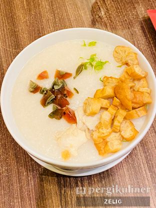 Foto - Makanan(Bubur Ikan & Phitan) di Ta Wan oleh @teddyzelig