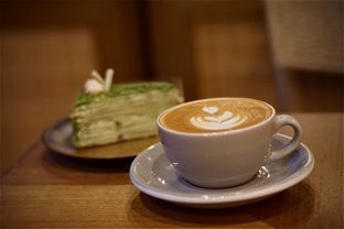 Foto 1 - Makanan(Cappuccino & Mille Crepe Green Tea) di Kopi Warga oleh Fadhlur Rohman
