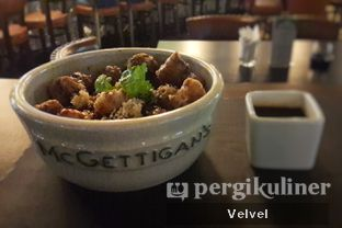 Foto 1 - Makanan(Pork Belly Pop Corn) di McGettigan's oleh Velvel