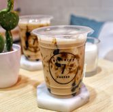 Foto Black sugar milk tea di District 7 Coffee